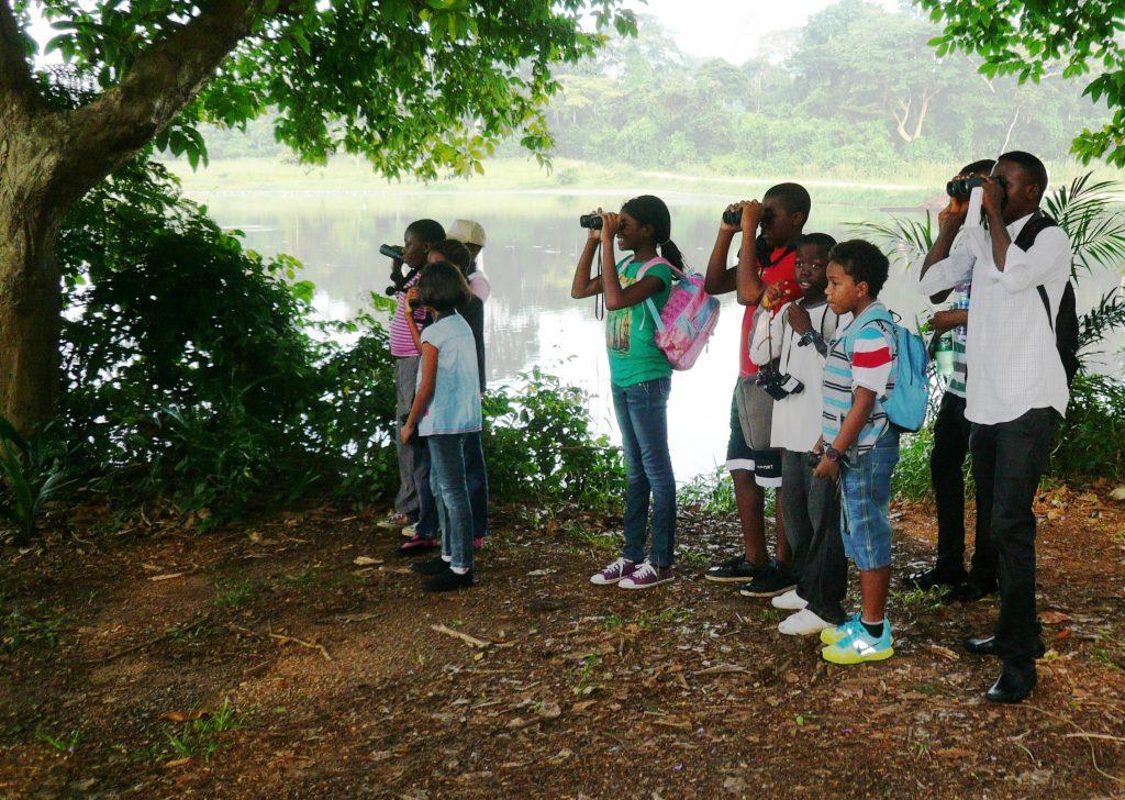 Picture of children bird watching in IITA Forest Reserve